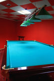 Pool tables in the bar. Billiard table in a red room Stock Photos