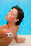 Pool tanning woman Royalty Free Stock Images