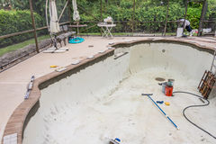 Pool tile border prep work Stock Photo