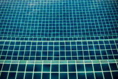 Pool tile. Close up texture of dark blue pool tile royalty free stock photography