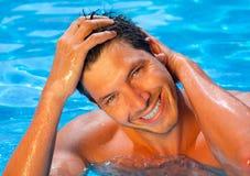 Pool time. Pool man relaxing travel time royalty free stock image
