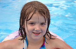Pool Time. An adorable five year old girl enjoys some recreational time in the pool Royalty Free Stock Photos