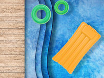 Pool top view with swim rings and inflatable raft Royalty Free Stock Photos