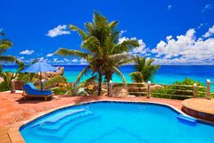 Pool at tropical beach. Vacation background royalty free stock photography