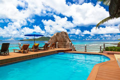Pool at tropical beach - Seychelles Stock Photo