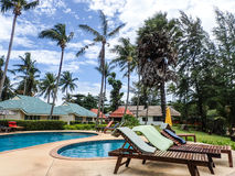 Pool at tropical resort. Blue pool and palm trees at tropical resort getaway, koh lanta, thailand Royalty Free Stock Images