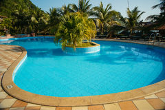 Pool in a tropical resort Stock Photo