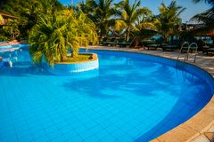 Pool in a tropical resort Royalty Free Stock Photo