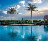Pool at tropical resort. Empty pool at tropical resort at the morning Royalty Free Stock Image