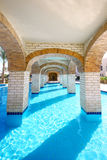 Pool under bridge. Swimming pool under bridge in resort Royalty Free Stock Photography