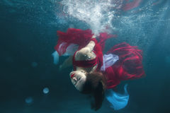 In the pool underwater dancing girl. Royalty Free Stock Images