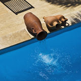 Pool Urns. Replica Greek urns used to fill swimming pool Royalty Free Stock Photography