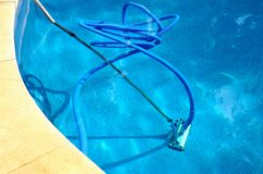 Pool vacuum cleaner on flexible hose. Stock Photos