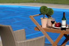 Pool view. Drinking wine by the pool side Royalty Free Stock Photo