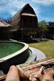 Pool View Garden Legs Holiday. Relax Travel Bali Indonesia Stock Photo