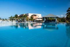 Pool View At Playa Paraiso Resort In Cayo Coco, Cuba. The main pool area at the Hotel Playa Paraiso Resort in Cayo Coco, Cuba. The all-inclusive beach resort was royalty free stock photos