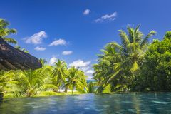 Pool view, Seychelles. A view from a pool on Petite Anse beach on Praslin island, Seychelles Stock Photo