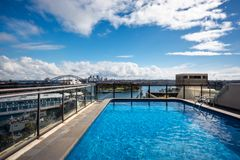 A pool with a view in Sydney, Australia. Potts Point, Sydney, Australia - September 03, 2018: Rooftop Swimming Pool in Potts Point on a beautiful sunny morning Stock Images
