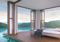 Pool villa bedroom with mountain view 3d rendering image. The bedroom floats above the pool. Inside is a wooden floor the doors are open on all sides. Touch Royalty Free Stock Photo