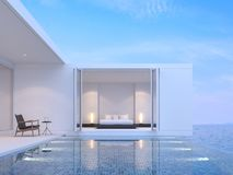 Pool villa bedroom with sea view 3d render. There are minimal style building.Funished with black wood bed. Overlooks to borderless swimming pool and sea view Royalty Free Stock Images