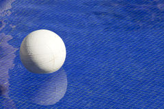 Pool Volleyball. White volleyball floating in a tile swimming pool. Off center for copy space Royalty Free Stock Photos