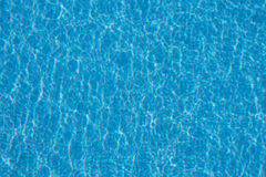 Pool water background - light reflection in swimming pool Stock Photography