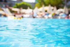 Pool water on blurred background of resort hotel. Beach royalty free stock photography