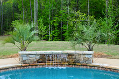 Pool Water Feature. Stone Water Fall Feature for SPA and Swimming Pool Stock Photos