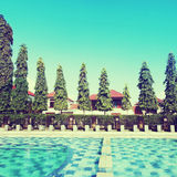 Pool with  water near houses. vintage effect Stock Image