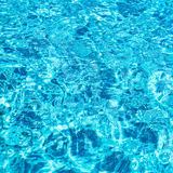 Pool water surface blue clear water reflection ripples square composition Royalty Free Stock Photo