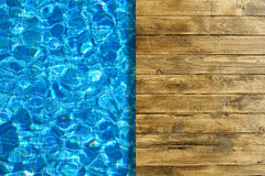 Pool water surface and wooden deck Royalty Free Stock Images