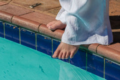 Pool Water Test Foot Summer. Testing water pool temperature with her toes to swim Stock Photos