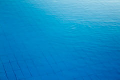 Pool water texture. Hotel swimming pool with sunny reflections Royalty Free Stock Image