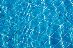 Pool water texture. Hotel swimming pool with sunny reflections Royalty Free Stock Photos
