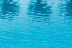 Pool water texture. Hotel swimming pool with sunny reflections Royalty Free Stock Photography
