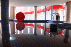 Pool and red water slide Royalty Free Stock Photos