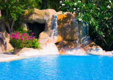 Pool and waterfall in hotel Stock Photography