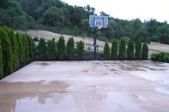 Basketball court in a luxury backyard Stock Photos