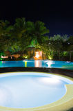 Pool and waterfall at night Stock Image