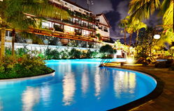 Pool and waterfall at night. Luxury resort with pool at night view Royalty Free Stock Image