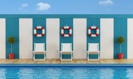 Pool with white deckchairs Stock Photos