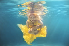 The pool woman swims underwater. Royalty Free Stock Photography