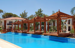 Pool and wood pergola Royalty Free Stock Photos