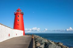 The Great South Wall and Poolbeg Lighthouse, Ringsend. Poolbeg Lighthouse on Great South Wall at the entrance of Dublin Bay, Ireland Royalty Free Stock Photos