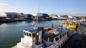 Poole harbour Dorset England UK with canoe sailing along stock footage