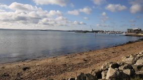 Poole harbour and quay Dorset England UK with sea lapping PAN stock video footage