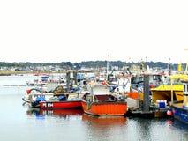Poole Harbour and Sandbanks, Dorset. Fishing boats in Poole Harbour with Sandbanks in the background at Poole, Dorset, England, UK Royalty Free Stock Photography