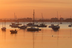 Poole Harbour at Sunset. Poole harbour bathed in orange light on a late summer evening Stock Photos