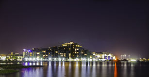 Poole At Night. Looking over Holes Bay toward Poole Quay. building made to look like cruise liner Royalty Free Stock Photo