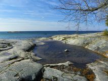 Pooled water at rock shore Royalty Free Stock Images